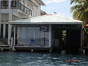 International real estates and rentals: Titled In-Town Waterfront Investment Property W/ Concession